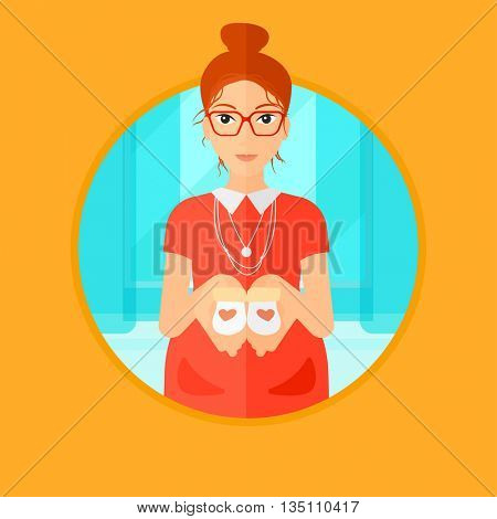 Pregnant woman holding baby booties in hands. Pregnant woman holding baby booties on the belly. Pregnant woman with baby booties. Vector flat design illustration in the circle isolated on background.