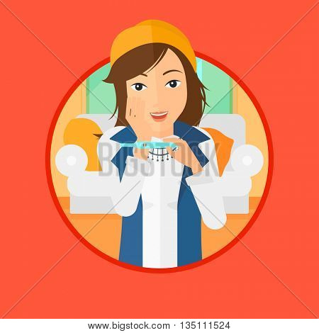 Delighted woman looking at positive pregnancy test. Young woman checking pregnancy test. Surprised woman holding pregnancy test. Vector flat design illustration in the circle isolated on background.