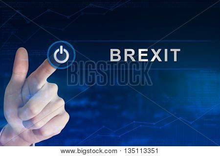 double exposure business hand clicking brexit or british exit button with blurred background