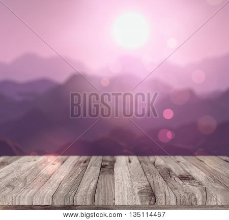 3D render of a wooden table looking out to a defocussed mountain landscape