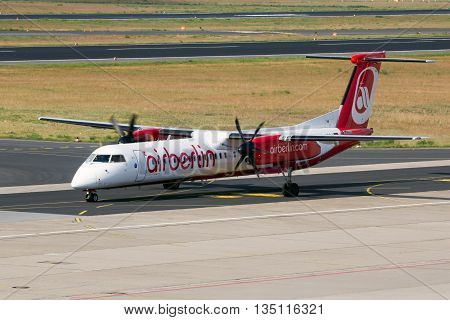 BERLIN - JUN 1 2016: Bombardier Q400 from AirBerlin taxiing before take-off at Berlin-Tegel airport