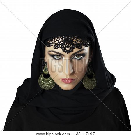 Beautiful Caucasian young woman with black fancy Arabian costume and ornamental jewelry on white background