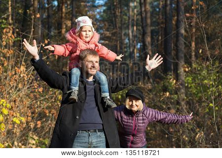 Happy Family the Walk in Forest Father Mother Little Baby Daughter Together Weekend Walk Park Sunny Day Smiling Faces Child Sitting on Daddy Shoulders