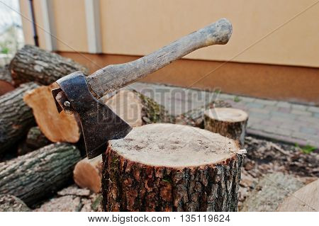 Axe in stump background chopped firewood outdoor