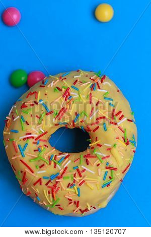 Round Donuts in the glaze on the blue background