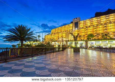 TAURITO, GRAN CANARIA, SPAIN - APRIL 20, 2016: Beach and resort complex in Taurito at night, Gran Canaria island, Spain. Taurito is very popular tourist destination on Gran Canaria.