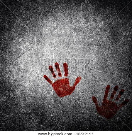bloody hand print on grunge wall