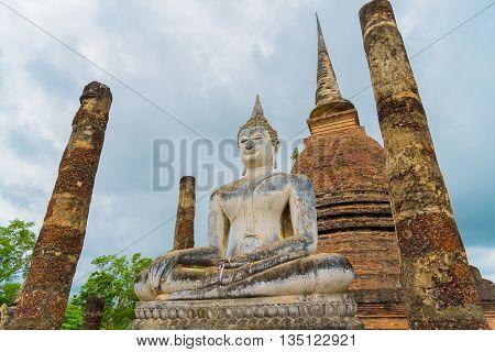 the Buddha statue at Sukhothai Historical Park, Thailand.
