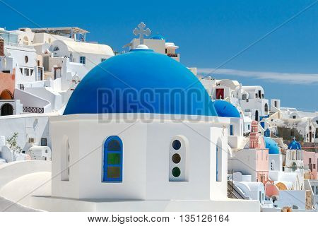 Blue dome on traditional Greek church in the village of Oia.