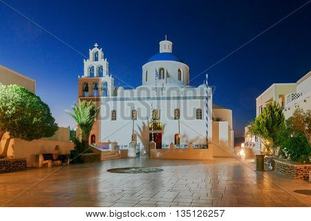 The main white blue orthodox church of Panagia Platsani night. Oia. Santorini.