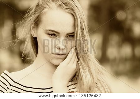 Close-up Of Thoughtful Girl In A Striped Dress Looking