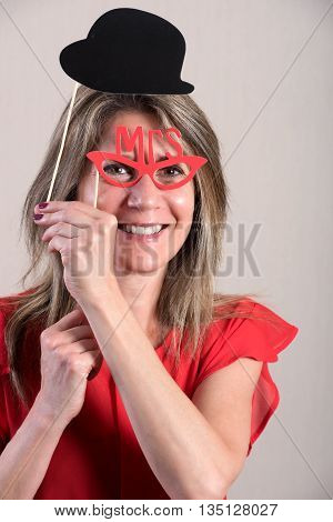 Middle Aged Woman Holding Funny Photo Booth Props