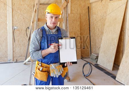 Portrait of foreman pointing at white folder plate