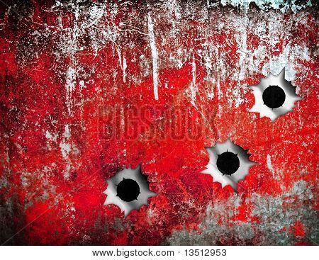 bullet holes in grunge metal plate