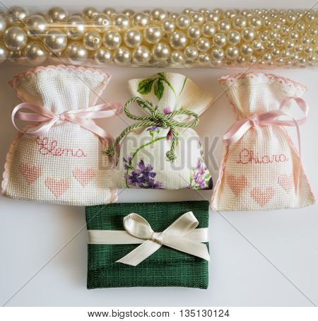 wedding favor bags containing sugar-coated almonds dates gift to the guests as a souvenir