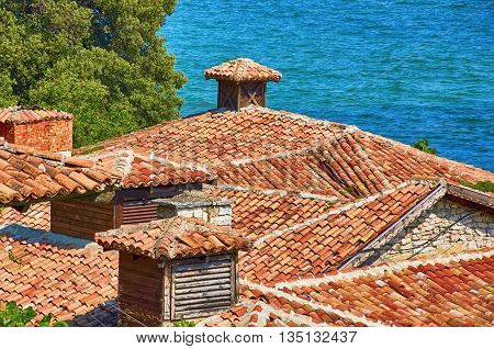 An Old Roofs from Terracotta Tiles in front of the Sea
