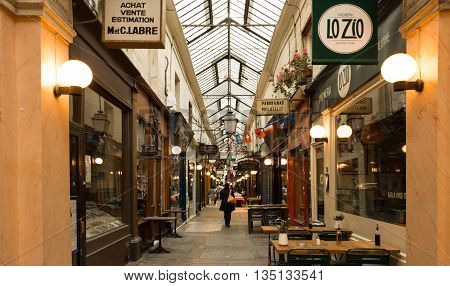 Paris France-June 18 2016 : The passage des Panoramas was built in 1800 this is the oldest covered arcade in Paris and the first to be lit by gas in 1817
