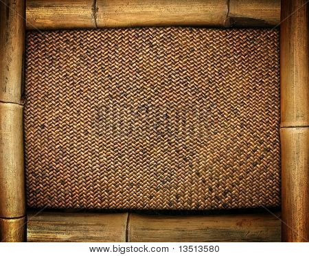 bamboo frame on rattan background