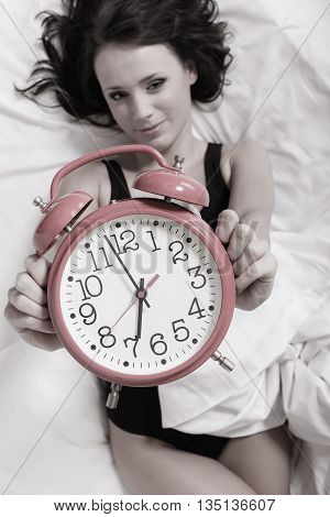 Sexy Lazy Girl Lying With Alarm Clock On Bed