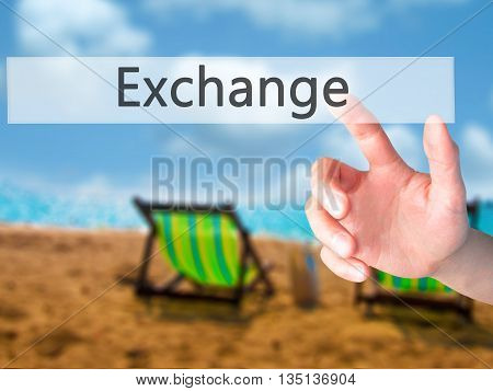 Exchange - Hand Pressing A Button On Blurred Background Concept On Visual Screen.