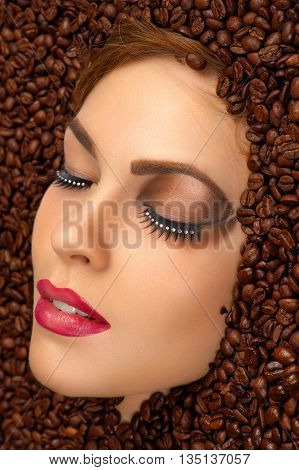 beauty face with bright makeup in coffee beans