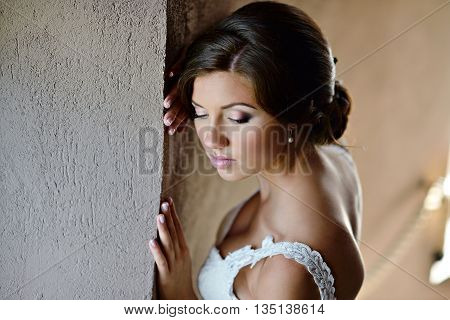 Beauty Bride In Lace Bridal Gown Indoors. Beautiful Model Girl In A White Wedding Dress. Female Port