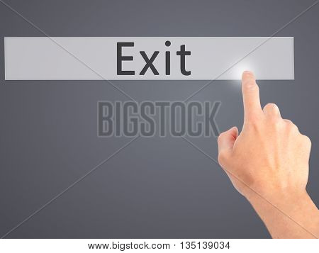 Exit - Hand Pressing A Button On Blurred Background Concept On Visual Screen.
