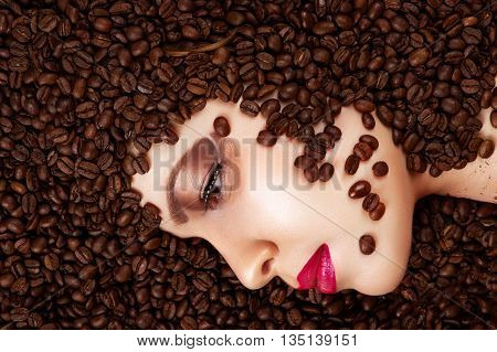 coffee beans in beauty profile face close up