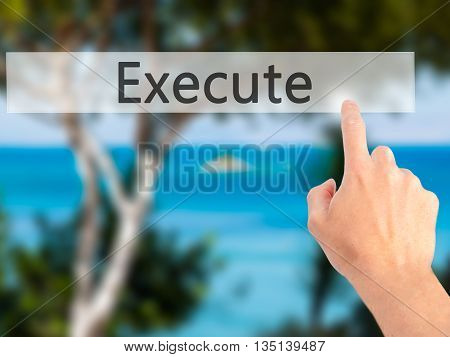 Execute - Hand Pressing A Button On Blurred Background Concept On Visual Screen.