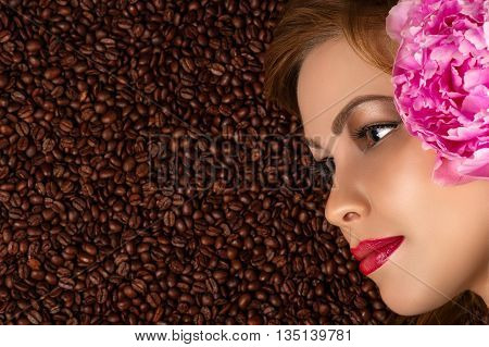 profile face with peony on coffee beans