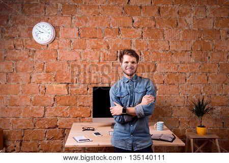 Business Person Sitting On Office Desk Wearing Smart Watch