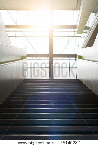 Stairs up inside the building and sun glare.