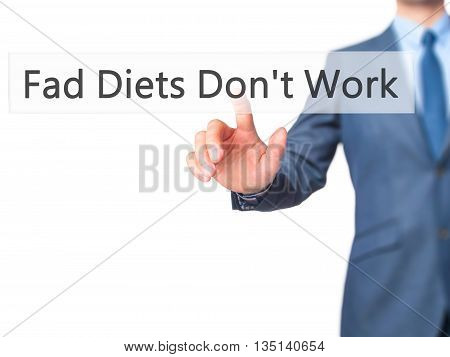 Fad Diets Don't Work - Businessman Hand Pressing Button On Touch Screen Interface.