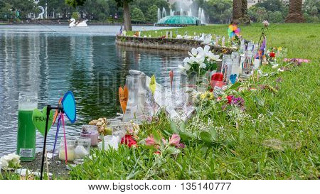 Orlando, FL - June 19, 2016: Makeshift memorial dedicated to the victims of the shooting at Pulse nightclub set up around Lake Eola, Orlando, FL.