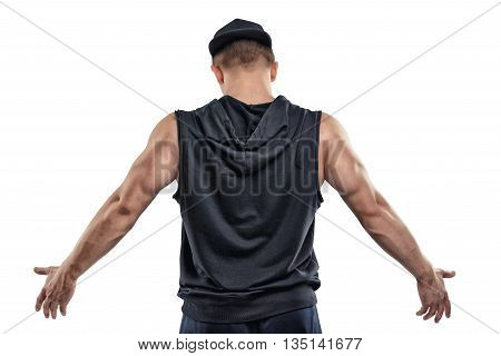 Back view of isolated fitness man posing and shows arm muscles. Posing. Power training. Healthy lifestyle. Fitness and sport. Youth and strength. Bodybuilder posing
