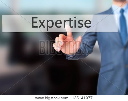 Expertise - Businessman Hand Pressing Button On Touch Screen Interface.