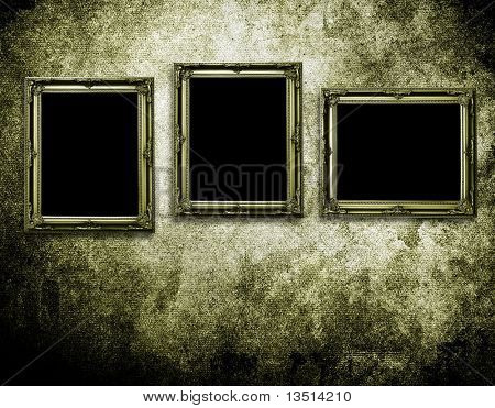 picture frames on grunge wall