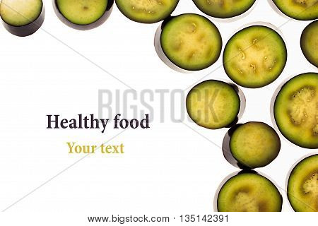 Decorative frame from circles of eggplant on a white background. Raw eggplant sliced. Isolated. Decorative border frame. Food background.