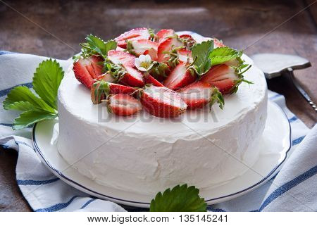 Delicious Strawberry cake with whipped cream and fresh strawberries