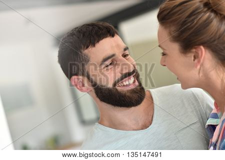 Cheerful hipster couple embracing each other