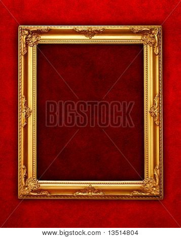 golden frame on red wall