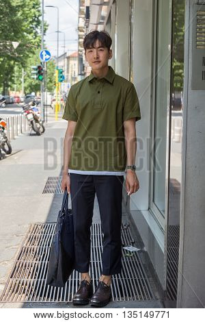 MILAN ITALY - JUNE 18: Fashionable man poses outside Marni fashion show building for Milan Men's Fashion Week on JUNE 18 2016 in Milan.