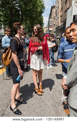 MILAN ITALY - JUNE 18: Fashionable people gather outside Marni fashion show building for Milan Men's Fashion Week on JUNE 18 2016 in Milan.