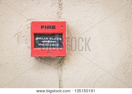 fire alarm switch on the wall concrete