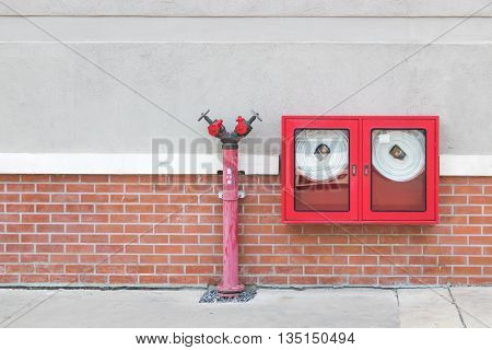 Hydrant with water hoses and fire extinguisher equipment