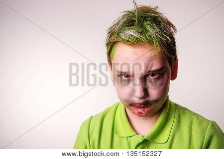 Teenager boy with a zombie makeup on Halloween