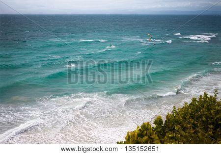 Kite surfer enjoying in waves on sea