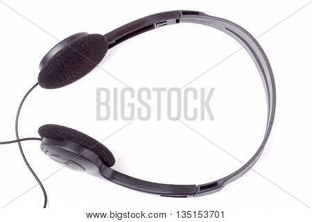 black headphones isolated on white background with a wire.