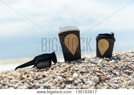 Coffee Cups And Glasses On The Seashore