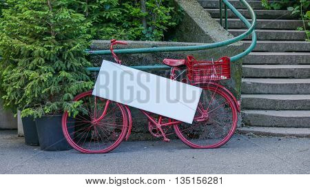 Old red bike and blank poster bacground